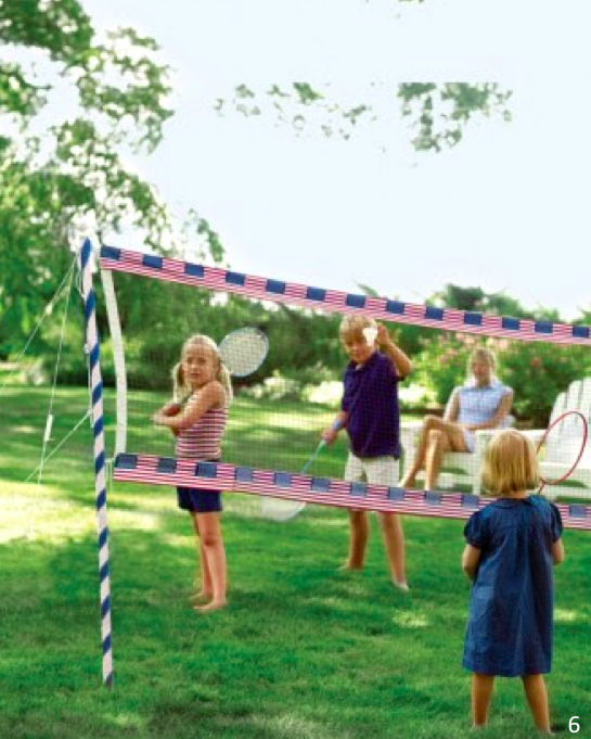 A badminton face-off is much more fun at a net embellished with flags - Let Freedom Ring - Fab 4th of July Decor ideas.